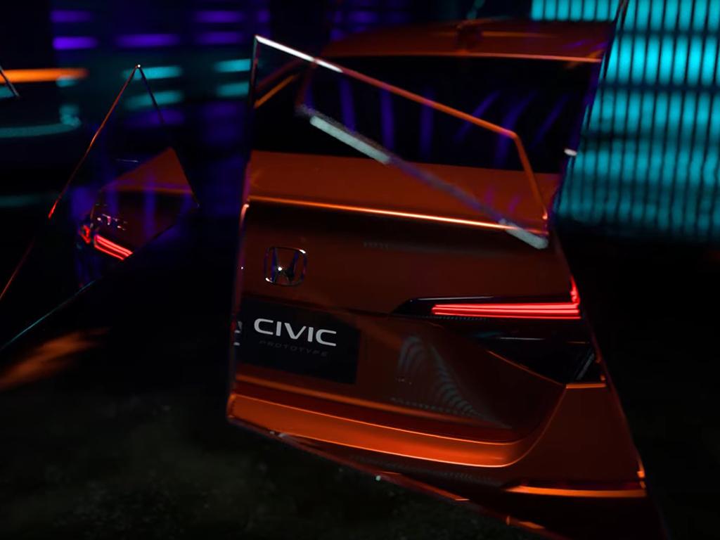 Bu görsel boş bir alt niteliğe sahip; dosya adı 2022-honda-civic-sedan-prototype-teaser-10.jpg